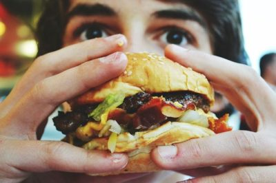 A-boy-eating-a-hamburger