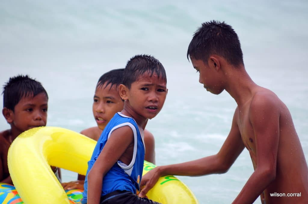 Boys playing in ocean
