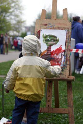 artist painter boy standing at easel