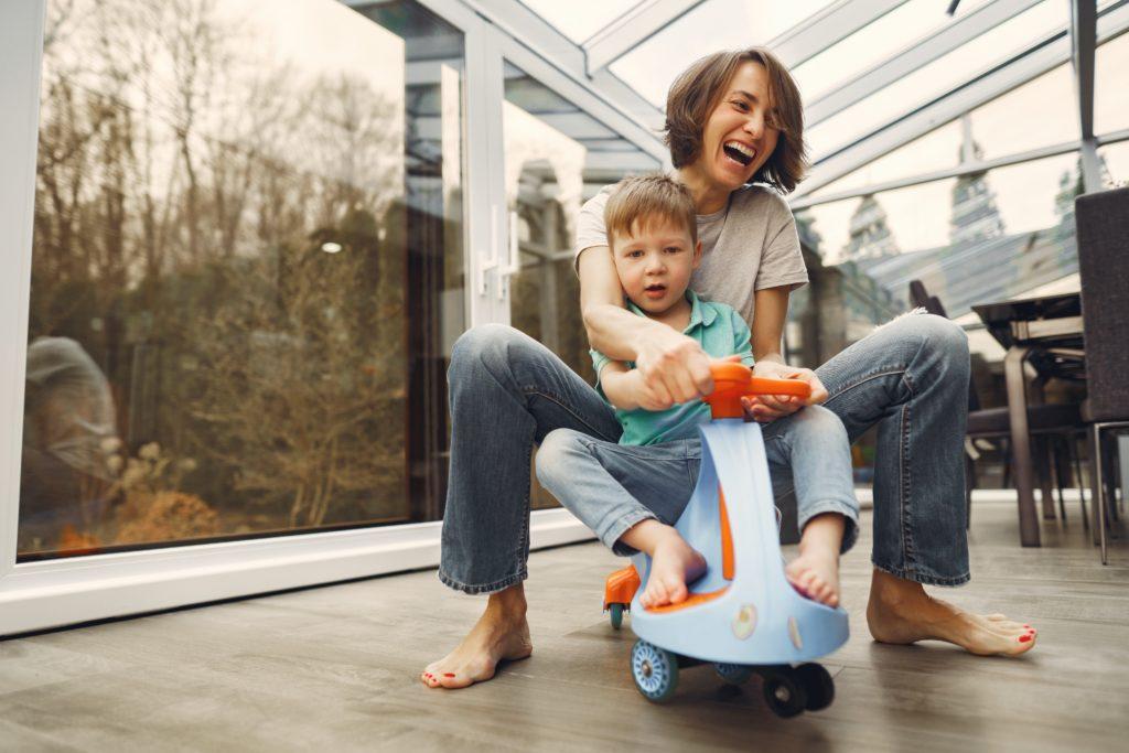 mother & son riding a twist car